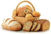 loaves of bread and rolls in a wicker basket